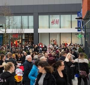 Crowds flock to first store openings